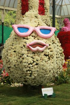 Miss Garlic with her blue-tinted, pink-rimmed glasses and pink-shaded lips