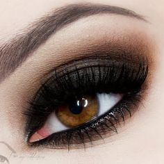 Create a smokey eye look that isn't too severe and is perfect for both daytime and nighttime. Natalia J uses brown and neutral eye makeup to soften and create a smokey effect.