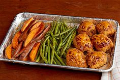 Serve a plate of our BBQ Chicken and Sweet Potato Sheet-Pan Dish at dinnertime tonight! Green beans add color to this chicken and sweet potato dish.