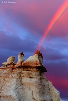 Monsoon clouds and a rainbow are colored by sunset on the Hopi Reservation, Arizona, USA
