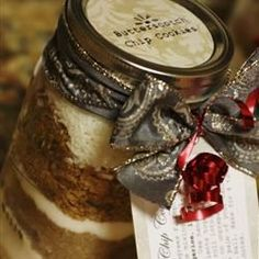 "Special Butterscotch Chip Cookies in a Jar Recipe: ""This is a cookie mix with an attached tag which gives the directions on how to prepare the mix and bake the cookies. Seasonal fabric or a particular kitchen decorating color scheme used for the cloth topper makes the jar attractive enough to display on a baker's rack until it is ready to be used."" — Sally Jo"