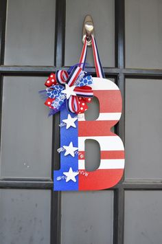 Fun DIY to make for your front door. Silver Peaches - 4th of July Door Decor