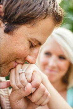 Cute engagement picture of him kissing her ring - Wedding look