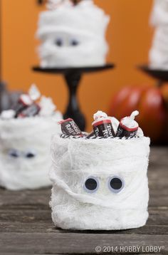 Cover boxes and lids with white felt, and then wrap strips of cheesecloth all over. Add some googly eyes, and that's a wrap!
