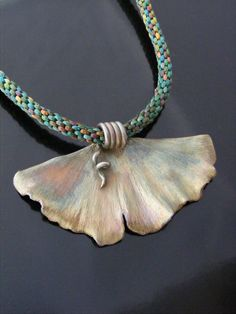 Fine Silver Ginkgo leaf on a hand braided Kumihino cord made by Magdalena Moon Designs.