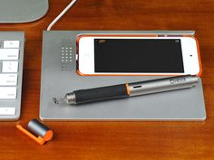 SketchDock: A Functional Dock. Trackpad : Music : Graphics by Jon Atherton — Kickstarter.  Transform Your iPhone With SketchDock. Multitouch Trackpad, Graphics Tablet, Media Control, Numberpad, Draw to Photoshop