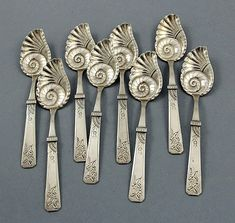 A set of eight sterling silver conch ice cream spoons by Duhme of Cincinnati with hand engraved satin finished handles and chased and engraved bowls. Sterling Silver Flatware, Silver Spoons, Silver Plate, Vintage Silver, Antique Silver, Ice Cream Spoon, Metal Working, Vintage Items, Antiques
