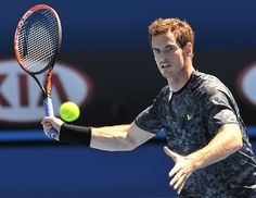 Andy Murray of Britain hits a return during a training session ahead of the Australian Open tennis tournament in Melbourne on January 16, 2015.
