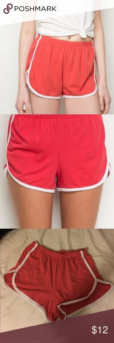 11 🅿🅿 Brandy Melville red running lisette shorts Red running track gym shorts from Brandy Melville super comfy and cute no rips or stains Brandy Melville Shorts