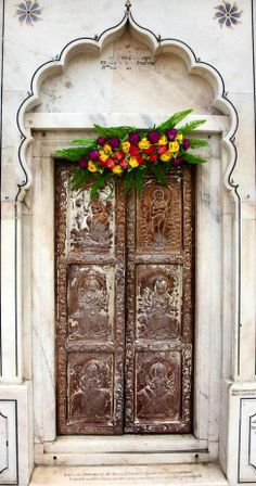 Amritsar, Punjab, India...how about a wooden garden gate with pressed tin tiles? it would really play on this idea....