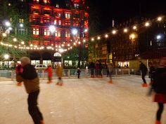 Blogmanay in Scotland - skating at Princes Street Gardens with Jenners lit up in red beyond #Blogmanay