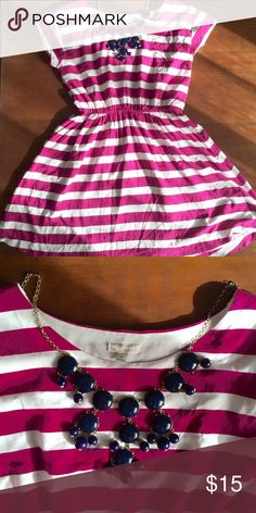 Gap Striped Nautical Dress S This dress is carefree and easy, and a gorgeous white and magenta stripe. It's a roomier small, with a very flattering waistline. Sadly does not fit me any more. Looks great dressed up and dressed down. Smoke free home. This listing is for the dress only, necklace not included. GAP Dresses