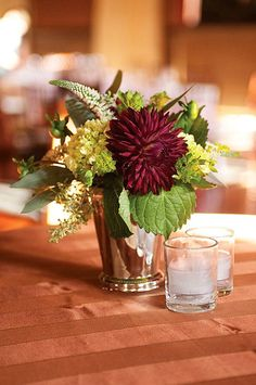 Dark red flowers for wedding table centre pieces.  Photo by http://hudsonnicholsphotography.com/