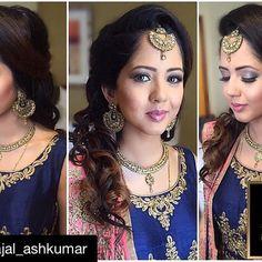 @kajal_ashkumar ・・・ The glamorous reception look for Veena. Blue & gold smokey eyes, contour & highlight, and glossy pink lips. For the hair: Half up, half down with voluminous messy curls. #akbride #makeup #hair #styling #makeupartist #bride #bridal #reception #wedding #asianbeauty #ashkumar #mua #internationalartist #ak #glam #blue #smokey #glitter #pink #curls #bighair #ashkumarbeauty