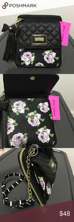 Betsey Johnson crossbody bag Betsey Johnson crossbody bag. All over black color with a quilted black flap, covering a panel of purple roses in front. Magnetic snap closure & polka dot name plate. Large compartment has one zipper, all the way around. Opens to reveal one large compartment with 8 card slots on back. Comes with black & white striped crossbody strap, not detachable. Also comes with detachable black bow & tassel keychain. Betsey Johnson Bags Crossbody Bags