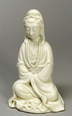 Blanc de Chine Figures, China, 19th century, Te Hua image of a seated Goddess of Mercy, ht. 11 1/2 in