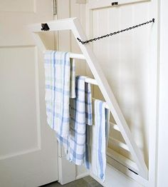 Put the wall behind a door to work by building a fold-up rack for air-drying towels or other small items. Make a simple frame of 1x2s and attach it to the wall. Assemble the drying rack from 1x2s and dowels to fit snugly inside the frame. A catch at the top keeps the rack in place when closed; hinges and a chain allow it to fall open for use./