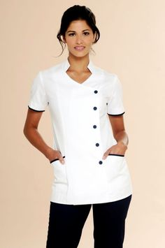 Elegant nurses uniform tunic buttoned to the side, Polyester / Cotton twill weave durable fabric. Buy online from Diamond Designs Dental Uniforms, Healthcare Uniforms, Nursing Uniforms, Spa Uniform, Uniform Shop, Beauty Tunics, Nursing Tunic, Beauty Uniforms, Scrubs Outfit