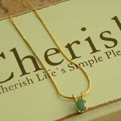 Pretty dainty feminine jade pendant necklace Love this gold colored chain with a small light green gemstone drop that looks so perfect and fabulous on