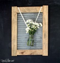 This could be a neat cabinet door look!! -rustic wood frame w/corrugated metal-