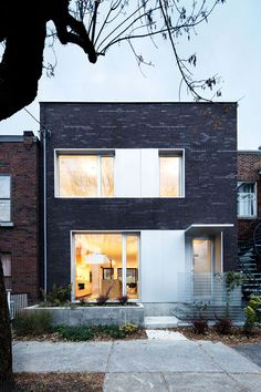 Dark red brick and grey alumnium, a timeless combination. Alexandra Residence by naturehumaine.