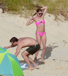 Thinking pink: Olivia Palermo was a willowy sight in a pink bikini as she hit the beach in...