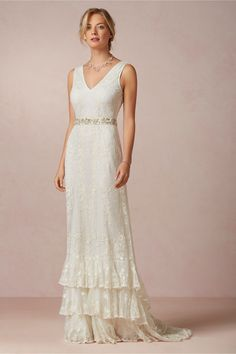 Madeline Gown from BHLDN | Inspired by a vintage dress the designer stumbled upon, the multi-tiered, embroidered skirt of this Candela gown adds an element of drama to its elegant silhouette. Back zip closure. Embroidered nylon mesh. Silk lining. | $1000