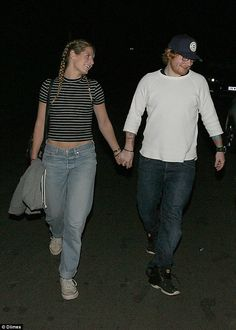 Dinner date: The loved-up couple, who are rarely photographed showing PDA, were smiling and holding hands as they left the restaurant