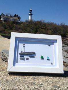 All glass is picked from the coast of Maine in the beautiful Two Lights area. Each piece of art in in a white 5x7 shadow box that can be set on a