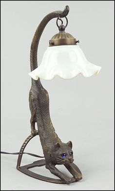 A PATINATED METAL CAT FORM TABLE LAMP. Lot 149-8045 #cat