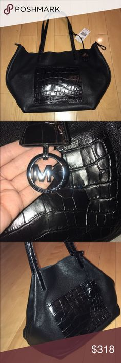 Michael Kori leather tote Brand new with tag, large Michael Kors black leather tote, front pocket, shoulder straps and side straps with crocodile pattern, very roomy with two slots inside. MICHAEL Michael Kors Bags Totes