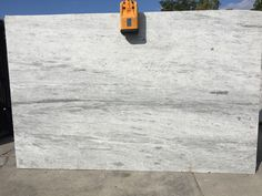 Glacier White granite has nice variation in stone looks like waves of ice with nice off white background in slab.