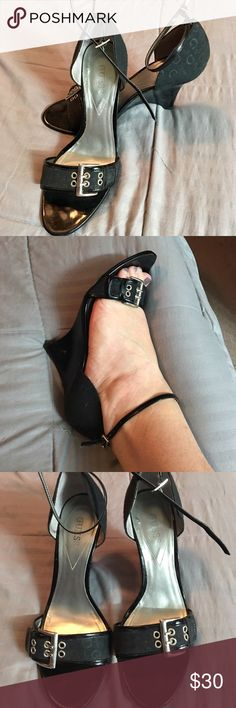 Sexy Guess wedge with silver and guess brand cloth Black Guess Wedge sandals w/ ankle strap & silver buckle detail on toe strap. Gently worn, some signs of wear on heels. Guess Shoes Wedges