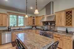 This 3,668 sq. ft. home's eat-in kitchen is fit for a chef with hickory cabinets, Viking refrigerator, DCS range and oven, and granite countertops. 26765 El Dorado Drive • Clark, CO