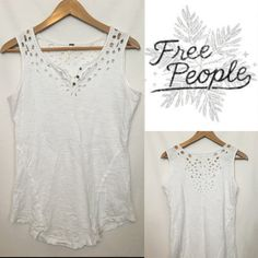 Free People white cutout Design top size Medium This gorgeous Free People top is a beautiful white color that goes with everything!  It has a beautiful cutout design through the top front and back as seen in the pictures!  Size medium!  Excellent used condition! Free People Tops