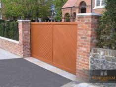 Aluminium Sliding Gate with Wood Effect Finish.