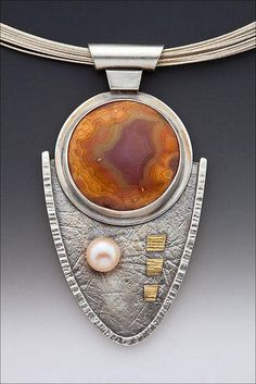 "Just Peachy by Linda Lewis Materials: Agate FWP Sterling Silver and 22k gold Dimensions: 1"" X 3"" Hand fabricated using hammers and handmade paper to create texture."