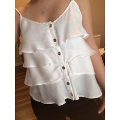 White ruffled top This has adjustable straps and in great condition! Body Central Tops Tank Tops