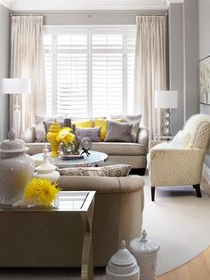 This beautiful, bright living room features shades of light gray.