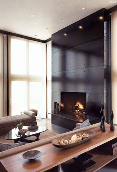 Modern fireplace surrounds black panels recessed lights contemporary home interior Modern Fireplace Mantels, Industrial Fireplaces, Metal Fireplace, Fireplace Surrounds, Fireplace Design, Modern Fireplaces, Fireplace Ideas, Fireplace Facade, Ethanol Fireplace