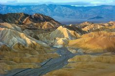 Zabriskie Point After Rain, Death Valley National Park by Alain Thomas our artist of the month! #mural