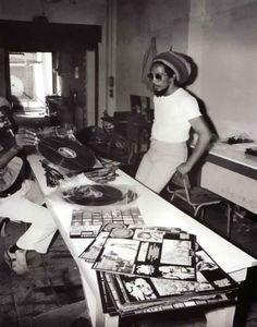 Bob Marley going through his record collection