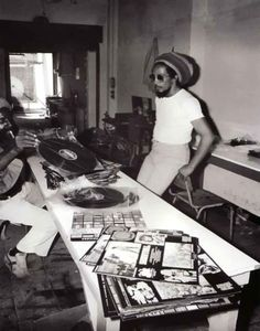 Bob Marley going through his record collection