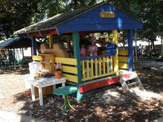 outdoor play house with mud kitchen.