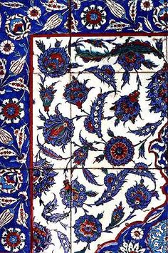 Magnificent Iznik tiles decorate the tomb of the Saint whose sarcophagus is bathed by garish green fluorescent lights.