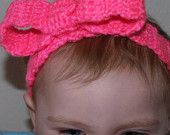 http://www.etsy.com/listing/90448469/crochet-headband-hot-pink-with-bow
