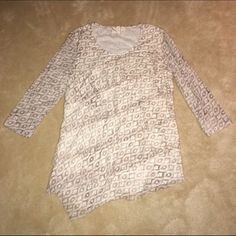 NWOT Chico's tiered geo print 3/4 sleeve top This Chico's tan & cream patterned tunic is bursting with wonderful details: tiered ruffles in front, an asymmetrical hem, and a fully lined bodice with semi-sheer 3/4 sleeves. Beautiful and perfect for spring! NWOT I'm open to offers & will do bundle discounts! ☮❤️✌️ Chico's Tops Tunics