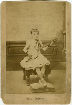 Daisy Belmont with a 5-string banjo. Mounted albumen print of circus performer  c. 1880