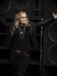 "Folk-rock star Melissa Etheridge performs live at RiverEdge Park Fri 7/22. With Bruce Springsteen- and John Mellencamp-like vocals she made smash hits like ""Come to My Window"" and ""I'm the Only One."" Melissa's raspy vocals, honest lyrics and grounded personality are synonymous with feminism and perseverance. She is also known for her ground-shattering performance of Janis Joplin's ""Piece of My Heart"" at the 2005 Grammy Awards."