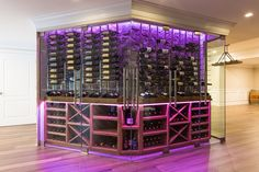 "Sleek and sexy low profile wine cabinet (23"" deep) w stone accents, climate control, led lighting, and glass doors #winestorage #winestorageideas #winestagram #josephandcurtis #wineroom #homedecorideas #homedecor #interiordesign Climate Control, Wine Cabinets, Wine Storage, Glass Doors, Wine Rack, Liquor Cabinet, Modern Design, Profile, Deep"